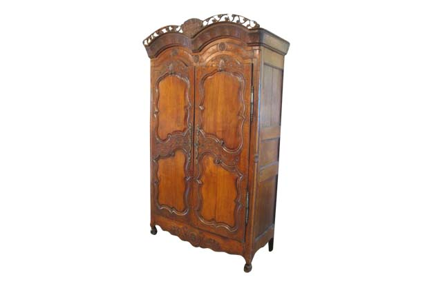 French Late 18th Century Cherry Armoire from Rennes with Hand Carved Décor